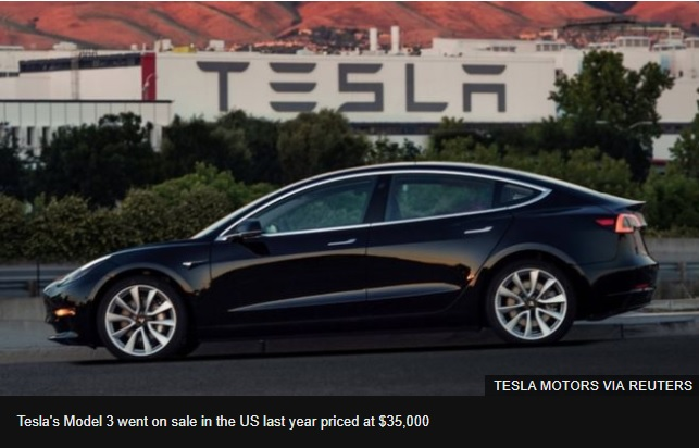 Tesla reports record loss but says outlook is positive